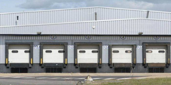 Large commercial building with bays.