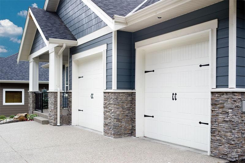 Front of house with driveway. & Residential Doors - Lux Overhead Door Saskatoon SK