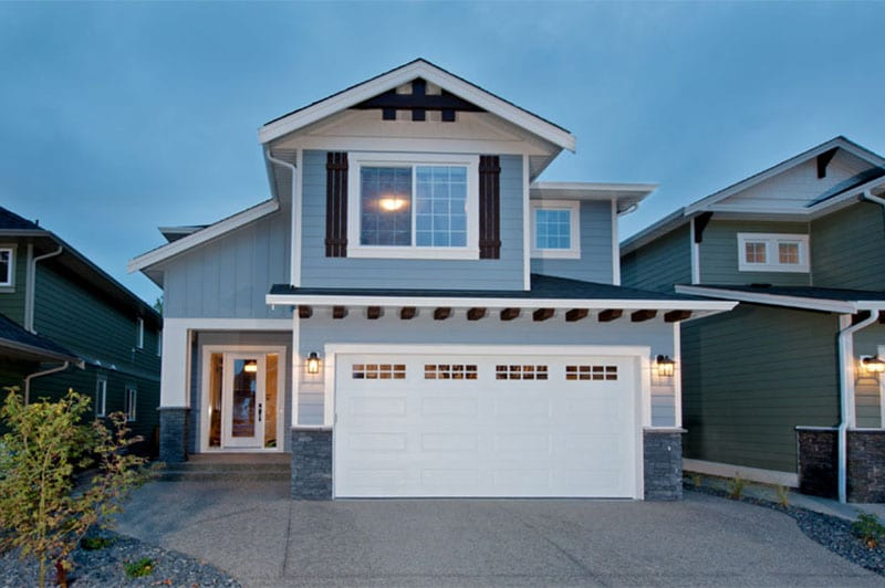 House with entrance to parking pad. & Residential Doors - Lux Overhead Door Saskatoon SK