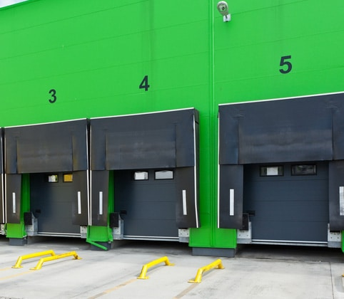 Row of Commercial Overhead Doors with Many Accessories